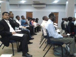 an audience following the procedures and presentations